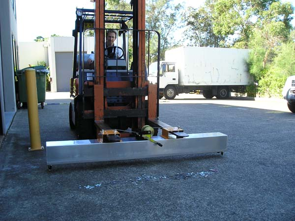 Magnetic sweeper fork lift mounted or towed